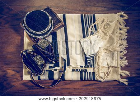 JERUSALEM, ISRAEL - DECEMBER 21: Jewish ritual objects, Talit and Tefillin with hebrew text, Kippah, and Siddur - jewish prayer book in Jerusalem, Israel on December 21, 2016