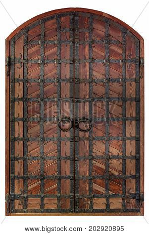 Antique wooden antique wooden doors with a forged iron grille and cross bars isolated on a white background.
