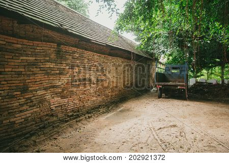 Old Brick Wall With Old Truck Rural Scene In Asia Upcountry