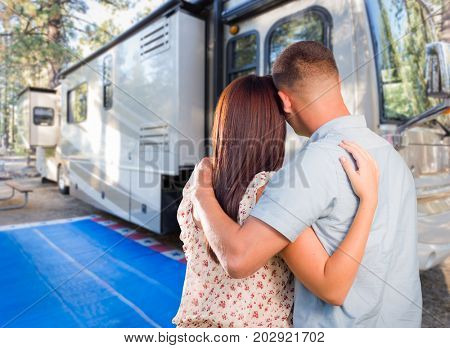 Military Couple Looking At A Beautiful RV At The Campground.