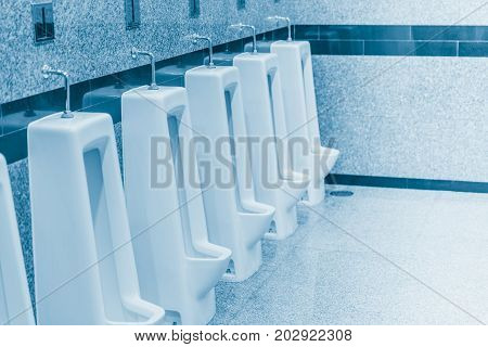 Clean urine in the men bathroom blue color