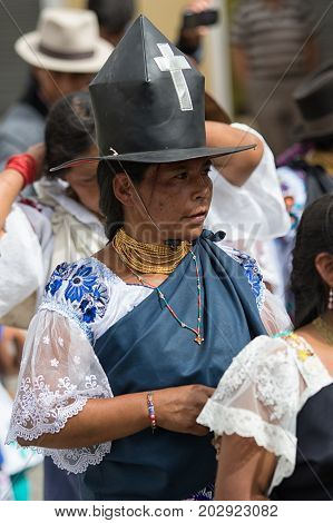 July 1 2017 Cotacachi Ecuador: traditionally dressed Kichwa woman at Punchi Warmi celebration wearing a large hat with cross sign on it