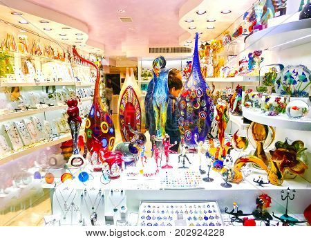 Venice, Italy - May 04, 2017: The shop with traditional souvenirs and gifts at Venice like Murano glass, Italy on May 04, 2017
