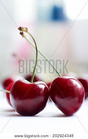 two berries, two cherries, berries still life, red berries