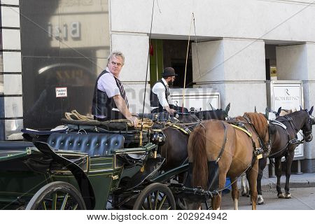 23 AUGUST 2017, VIENNA, AUSTRIA: Traditional horse-drawn carriages with cabs for tourists to walk along the ancient streets of Vienna.