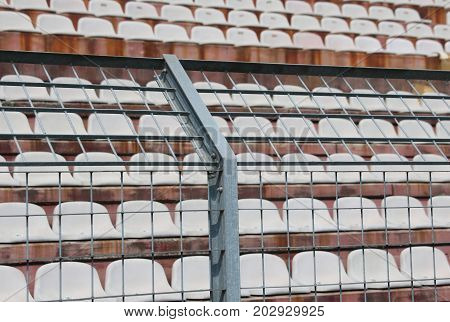 Metal Fence In The Stadium To Divide The Fans On The Pitches Fro