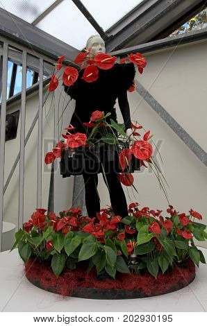 KEUKENHOF, NETHERLANDS - MAY 5, 2016: Calla lilly floristic decor and dummy in flower greenhouse Keukenhof Garden, Lisse, Netherlands. Keukenhof is the world's largest flower garden.