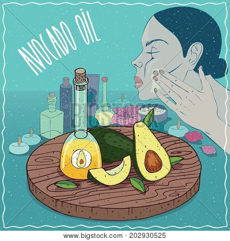 Glass Decanter of Avocado oil and fruits of Persea americana plant. Girl applying facial mask on face. Natural vegetable oil used for skin care