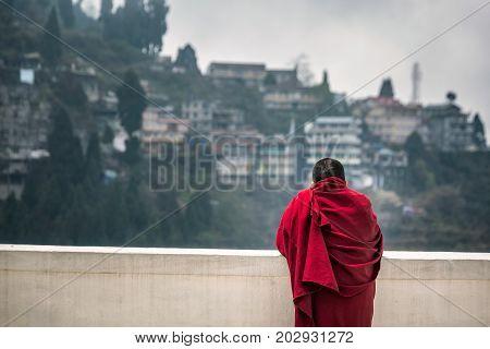 Monk admiring the view at Dali buddhist Monastery, Darjeeling, West Bengal, India.