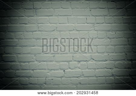Brick wall with dark edges (as an abstract gloomy background) retro style