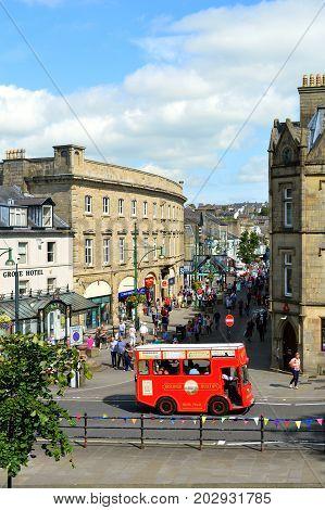 Buxton Derbyshire England UK Europe - August 28 2017 : Buxton tour bus taking tourists around the centre of Buxton town