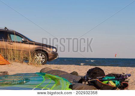 Windsurf kitesurf concept background with car, tent, sea, freedom