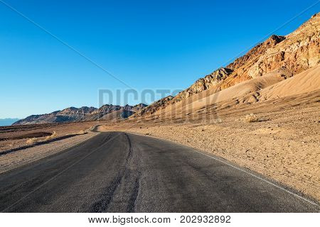 Beautiful view of brown hills and Artists Drive in Death Valley National Park in California
