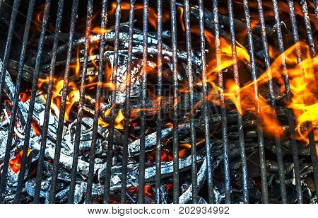 Empty Flaming Charcoal Grill With Flames Of Fire close up