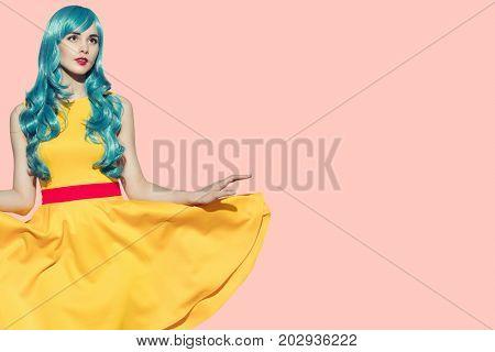 Pop art portrait of beautiful woman. Yellow fluttering dress and blue hair.