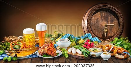 Beer, pretzels and various Bavarian specialties. Oktoberfest background