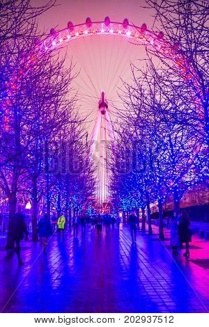 LONDON, ENGLAND - DECEMBER 18: London Eye on December 18th 2015 in London. The 135 meter landmark is a giant Ferris wheel situated on the banks of the River Thames in London, England.