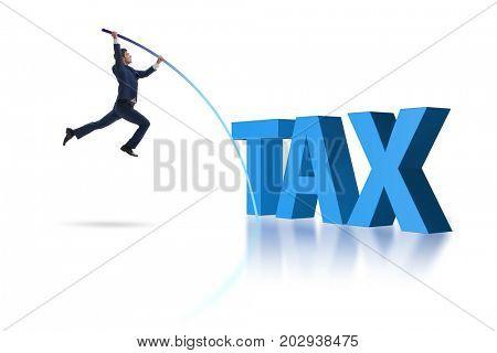 Businessman vault jumping over tax