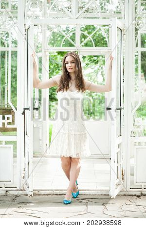 Beautiful Woman in White Lacy Dress in Summer Pavilion
