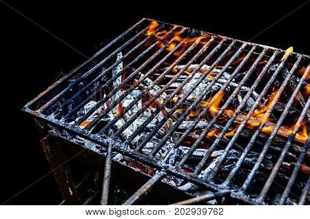 Hot BBQ Grill with Bright Flame isolated on black background