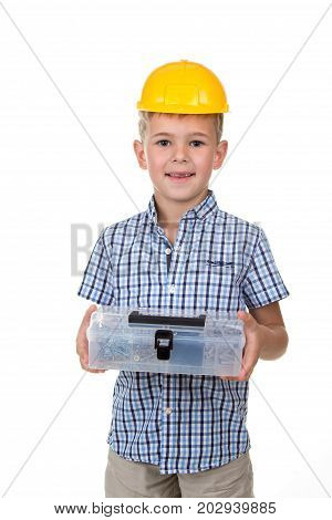 Emotional portrait of handsome boy wearing blue checkered shirt and yellow hard hat. Happy child holding toolbox, isolated on white background. Funny cute guy - construction worker or architect.