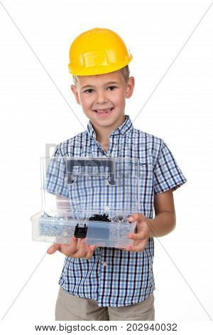 Portrait of cute smiling boy wearing blue checkered shirt and yellow hardhat, holding opened toolbox, white background. Funny handsome guy - construction worker.