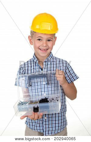 Studio picture of handsome smiling boy in a blue checkered shirt and yellow helmet, holding opened toolbox, white background