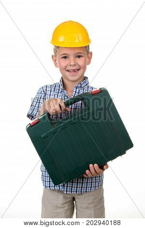 Studio picture of a young handsome happy future builder in a beautiful blue checkred shirt and yellow helmet, holding toolbox