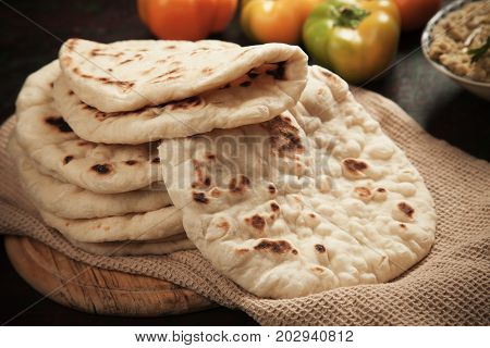 Home made turkish pita bread with hummus and peppers