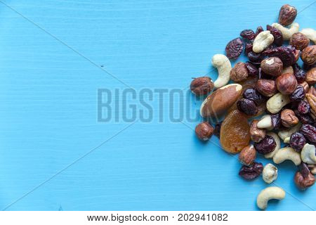 Healthy quick snack in office. Dry fruits and nuts on desk