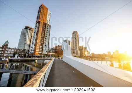 Cityscape view on the modern district with beautiful skyscrapers at the Rijn port during the morning in Rotterdam