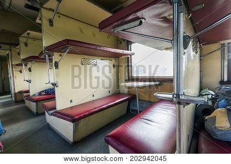 Vintage train interior with sleeping car seats