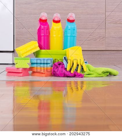 Cleaning Products On Kitchen Floor