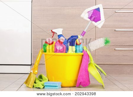 Cleaning Products In Bucket In Kitchen