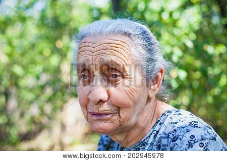Senior woman with severe osteoporosis spending time in the nature