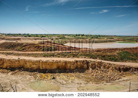 Industrial landscape, open cast limestone mining quarry