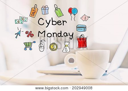 Cyber Monday concept with a cup of coffee and a laptop