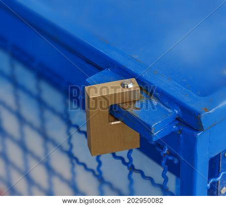 Padlocked on blue iron fridge close up
