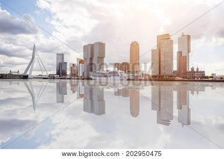 Landscape view on the beautiful riverside with skyscrapers and bridge in Rotterdam city