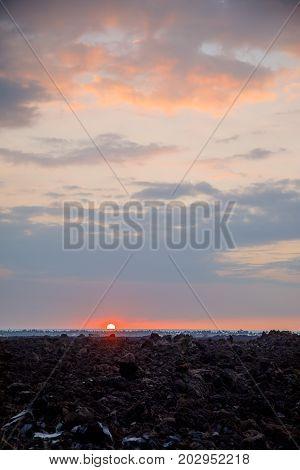 Big Island beautiful sunset over lava rocks in Hawaii