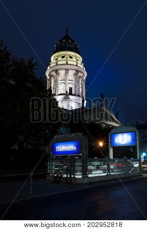 Berlin. German Cathedral on Gendarmenmarkt and the entrance to the underground station Stadtmitte
