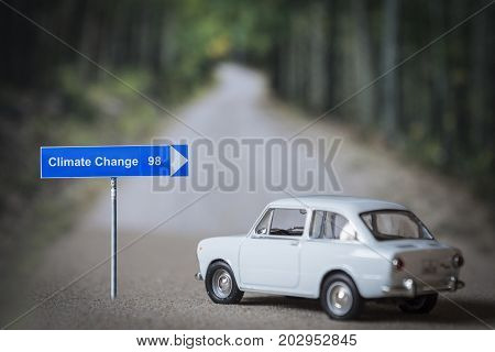 Miniature car on the road, choose address climate change, conceptual image global decisions