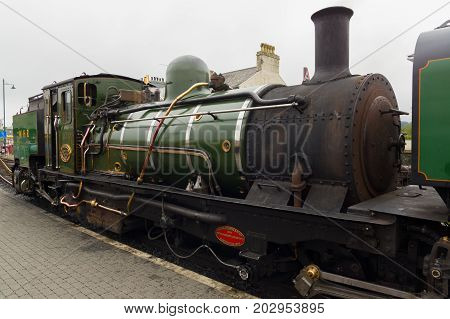 Porthmadog Wales UK - September 4 2017: Ex-South African Railways NGG16 class narrow gauge Beyer Peacock steam locomotive number NG143 operated on the Welsh Highland Railway by the the Festiniog Railway Company