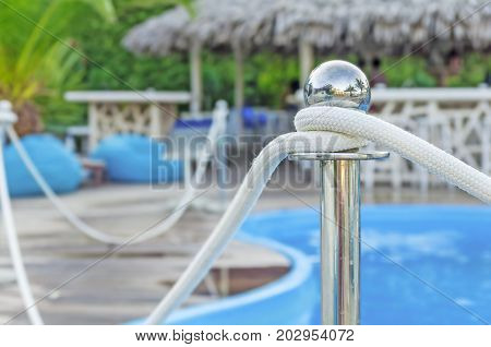 Pool rod and blurred background pool and bar house