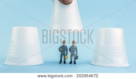Game of wits with three glasses of plastic, figures thumbnail of men, conceptual image
