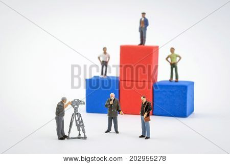 Podium winners, live of television, miniature figures isolated on white background