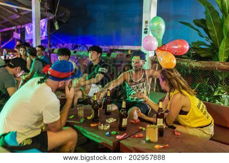 Vang Vieng, Laos - January 21, 2017: Young backpackers having fun in one of the bars in Vang Vieng, Laos