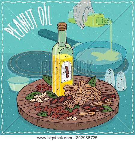 Glass bottle of Peanut oil and Peanuts. Hand pouring oil on frying pan. Natural vegetable oil used for frying food