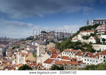 Beautiful view from Costa del Castelo street towards Augusto Gil gardens Jardim Augusto Gil with beautiful church of the Grace Igreja Convento da Graca Alfama Lisboa Portugal poster