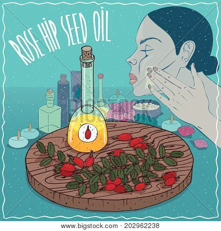 Glass Decanter of Rose hip seed oil and flowers and leaves of Rosa plant. Girl applying facial mask on face. Natural vegetable oil used for skin care